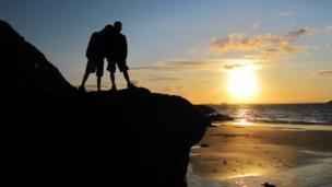 Boys on North Berwick beach at sunset