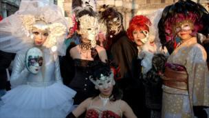 Faces hidden behind masks at the Venice Carnival