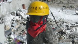 A Jizo statue wearing a safety helmet in Onagawa in Japan.