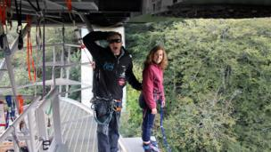 Phyllis standing on a platform and prepared to do a bungee jump