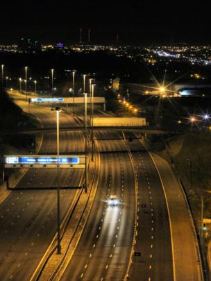 Aerial view of the M8 motorway at night