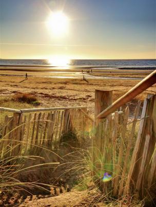 Sun setting over Troon beach