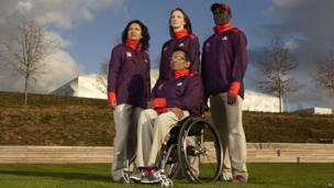 Games Maker volunteers model their uniforms for the 2012 London Games.