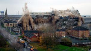Tower block being demolished