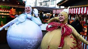Two women dressed up as Christmas decorations