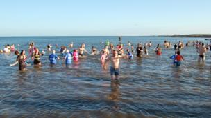People in the sea for Dunbar's Loony Dook