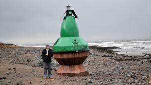 Marine navigation buoy on the beach