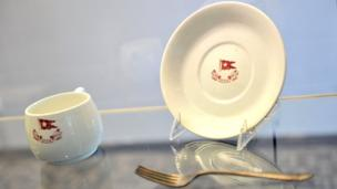 cup, saucer and fork