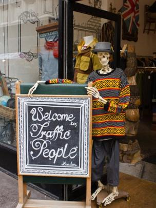 Skeleton outside a shop
