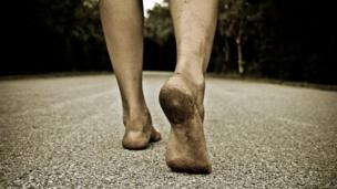 A person's dirty feet