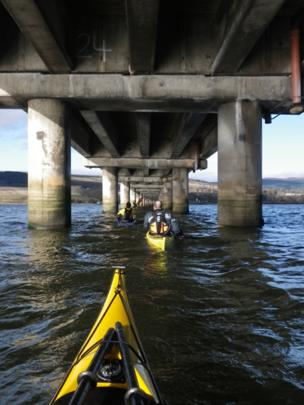 Kayaks under the Cromarty Firth road bridge