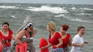 Women in the sea by the shore