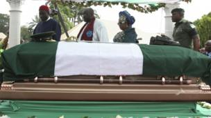 Nigeria President Goodluck Jonathan, left, his wife Patience Jonathan, second right, and Emeka Ojukwu, the son of the deceased, second left, attend the funeral of Chukwuemeka Ojukwu