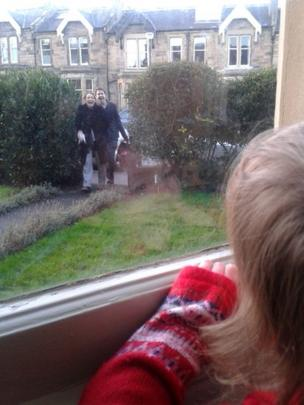 Daisy watches her parents Catherine and Andy Lothian arrive home with new baby Alice