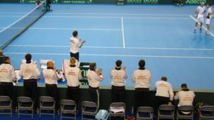 People cheer on competitors in the Davis Cup