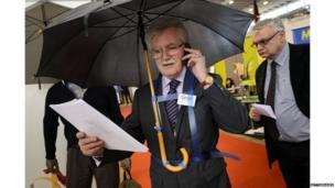 A man with a hands free umbrella