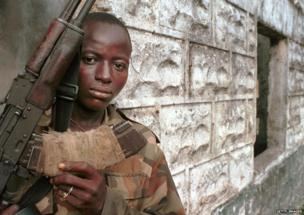 A teenage Revolutionary United Force rebel soldier. The RUF, infamous for their forced recruitment of child soldiers and maiming of civilians, slowly started to disarm and turn children soldiers over to international aid groups.