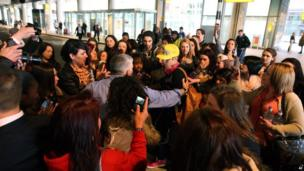 Justin Bieber mobbed by fans at London's Heathrow Airport