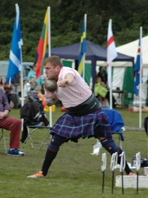 Man takes part in Highland Games