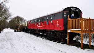 An old postal service train carriage being used as a cafe