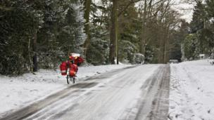 Royal Mail bicycle parked on an icy lane
