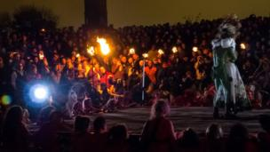Crowd watches performers during Beltane Fire Festival