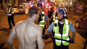 A man faces off with police during a protest against rising tuition fees in Montreal, Canada 23 May 2012