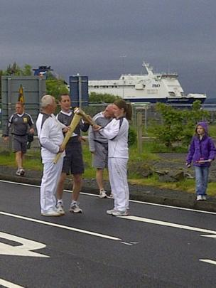 Olympic torch is handed over in Cairnryan
