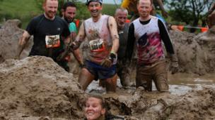Participants make their way through the 10,000 gallons of mud