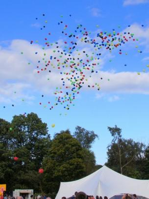 Balloons are released into the air