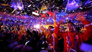 Paralympians celebrate at the closing ceremony.