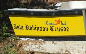 robinson crusoe life on the real island news boat robinson crusoe sign at back
