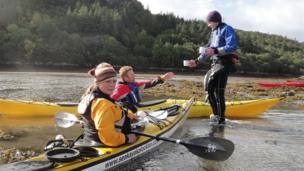 Hugh Evans, Will Evans and Alison French take a coffee break during a sea kayaking holiday in Plockton. Image taken by Richard Manley from Cheshire.