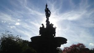 Fountain in silhouette against the sky