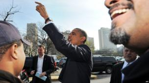 US President Barack Obama greets supporters outside a campaign office in Chicago, Illinois