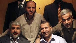 Ahmed Jabari (bottom right) poses with Hamas leader Khaled Meshal (bottom left) in Cairo last year.