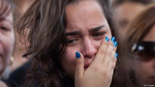 A woman mourns at the funeral of Itzik Amsalem
