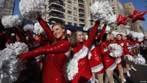 Dancers perform on Central Park West during the Macy's Thanksgiving Day Parade in New York on 22 November 2012