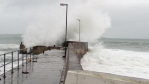 Waves on pier at John O' Groats