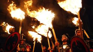 Up Helly Aa vikings from the Shetland Islands, hold lit torches during the annual torchlight procession to mark the start of Hogmanay.