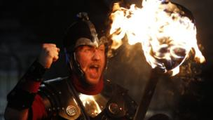 Up Helly Aa Viking Erik Burgess from the Shetland Islands, shouts while holding a lit torch during the annual torchlight procession to mark the start of Hogmanay (New Year) celebrations in Edinburgh