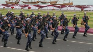Members of the armed forces parade for National Day Parade in Doha. The country has a small armed force but has actively supported revolutions in Syria and Libya with money, diplomatic action and even weapons.