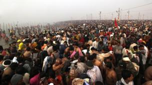 Millions of Hindu devotees gather early in the morning at Sangam, the confluence of the Rivers Ganges, Yamuna and mythical Saraswati, on the first day of the Kumbh Mela.