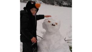 Joshua with his snowman