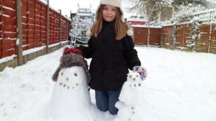 A girl with her snowmen.