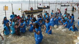 Former scavengers who travelled to the Kumbh Mela with an NGO