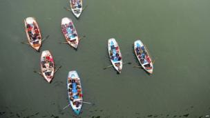 Boats carry people to Sangam