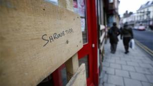 A shop in Ashbourne with a protective plank
