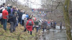 The game spills over into the River Henmore