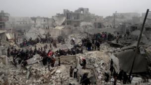 Syrians inspecting destruction